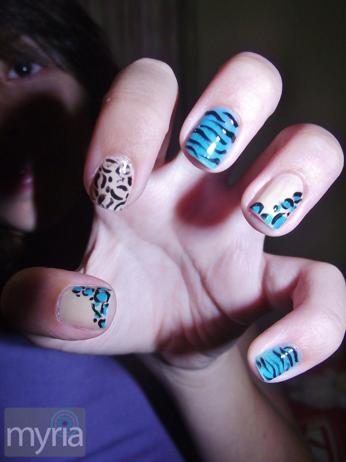 Animal pattern manicure on blue