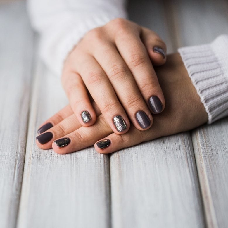 Beautiful manicure with brown nail polish