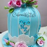 Blue bird cage cake with flowers