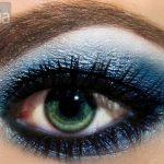 Blue eyeshadow on a green eye