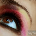 Bright pink eyeshadow on a brown eye