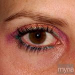 Brown eye with pink and yellow eyeshadow