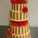 Brown vertical stripes and red roses on wedding cake