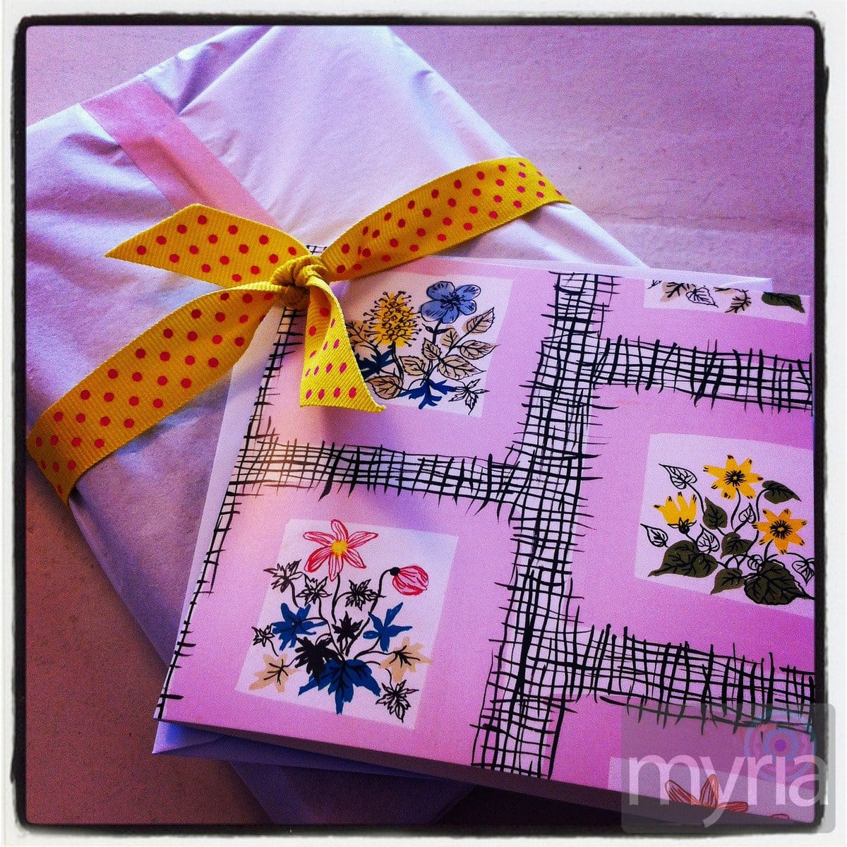 Creative gift wrap to make this card, attached with colorful ribbon to tissue-paper covered present