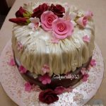 Creative wedding cake with fabric-style frosting and flowers