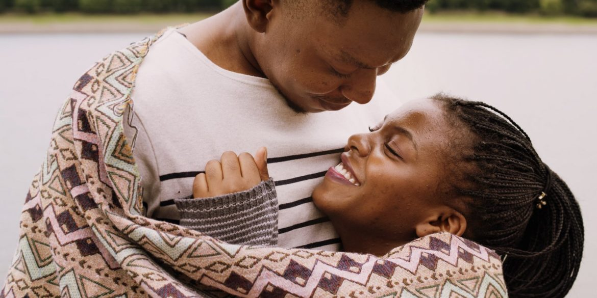 Cut couple hugging outside - How to reboot the romance in your long-term relationship