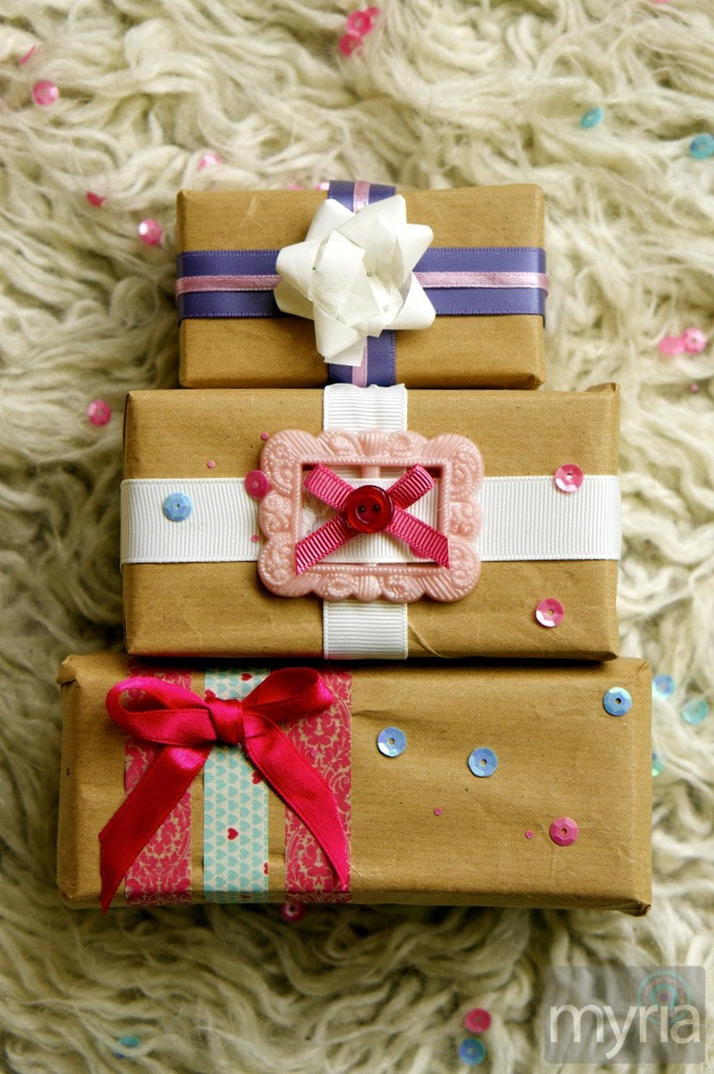 Cute wrapped gifts with fun embellishments of ribbon, buttons and sequins