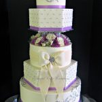 Purple and white buttercream tiered cake