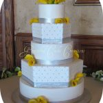 White and Silver Wedding Cake with Yellow Calla Lilies