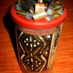 A simple canister turned into a cute gift container with bow