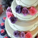 Flower wedding cake with cupcakes