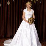 Graceful short-sleeved wedding dress with conservative V neckline