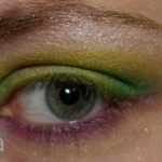 Green eyeshadows with lower purple liner