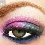 Multi colored eyeshadow on a super macro green eye