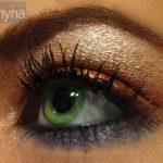 Orange and purple eyeshadow on a green eye