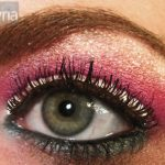 Pink and Turquoise Eyeshadow with silver glitter on green eye