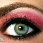 Pink and orange eyeshadow on a green eye