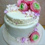 Pretty white wedding cake with pearl and sugar paste flowers