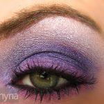 Purple eyeshadow on a green eye