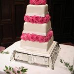 Real roses on this elegant stacked wedding cake