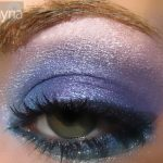 Shimmery purple and blue eyeshadows on a green eye
