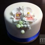 Simple wedding cake with sugar orchids
