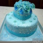 Sweet blue cake with fondant flowers and pearls