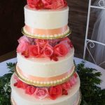 Three-tier wedding cake with pink roses