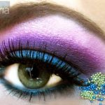 Vibrant eyeshadows in blue and purple, with tiny bead embellishment