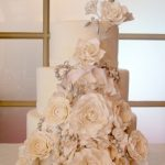 Vintage textured wedding cake with cabbage roses and other flowers