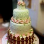 Whimsical garden wedding cake in light green and pink