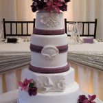 White and purple sculpted wedding cake with flowers