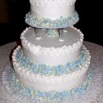 White wedding cake with little blue flowers