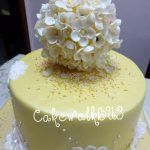 Yellow and white floral wedding cake