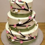 Branches, flowers and ribbon wedding cake