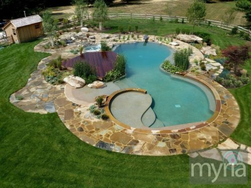 A natural pool that's the centerpiece of the backyard