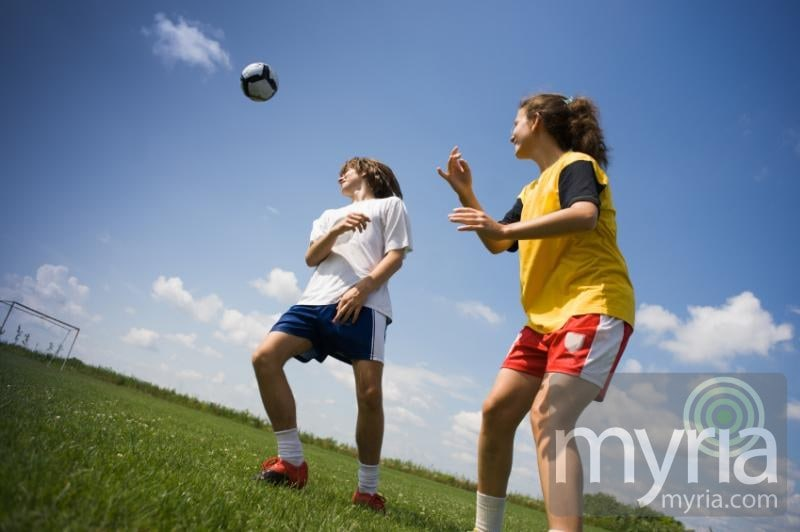 teens-soccer-playing-sky