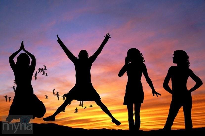 women-girls-jumping-sunset